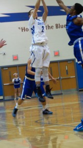 Saratoga senior Jordan Buchas, in white, takes a shot during Friday's varsity game.Sam Cherubin / Blue Streaks Basketball