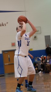 Saratoga senior Zach Kircher takes a shot during Friday's varsity game. Kircher was one of the game's high scorers with eight of the Blue Streak's 57 points.Sam Cherubin / Blue Streaks Basketball