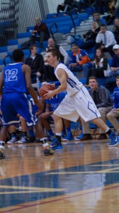 Saratoga senior Jack Herman tries to get past Shaker senior Ed Shields.Sam Cherubin / Blue Streaks Basketball