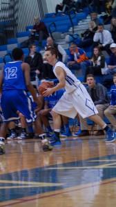 Saratoga senior Jack Herman tries to get past Shaker senior Ed Shields.Sam Cherubin / Blue Streaks Basketball