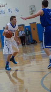 Saratoga senior Chris Byno dribbles past Shaker senior Seamus McHugh. Sam Cherubin / Blue Streaks Basketball
