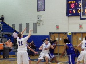Saratoga senior Zach Kircher takes a shot during Friday's varsity game. Kircher was one of the game's high scorers with eight of the Blue Streak's 57 points.Eli Fisher / The Lightning Rod