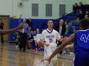 Saratoga senior Sean Grecco dribbles down the court during Friday's varsity game.Eli Fisher / The Lightning Rod