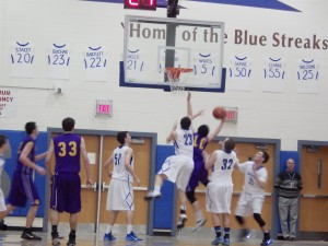 Saratoga's Jordan Buchas (#23)blocks the shot of a Ballston Spa player during Tuesday's game.