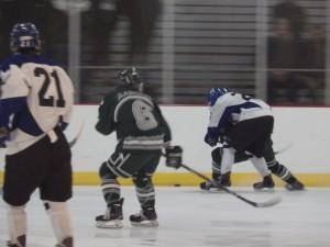 Shenendehowa's Chris Aarons (#6) looks on as a Saratoga player races for the puck. Aarons scored one of Shen's three goals.