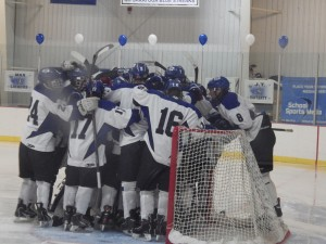 Saratoga's huddle at the beginning of the third period, during which they would advance from a 2-2 tie to win the game 4-3.
