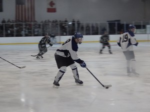 Saratoga's Elliott Hungerford skates with the puck early in the third period. Hungerford posted one assist during the game, one of eight Blue Streaks to score or assist.