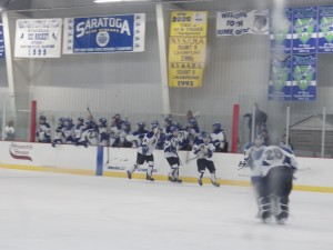 Blue Streaks celebrate after Cam McCall's game-winning third period goal.