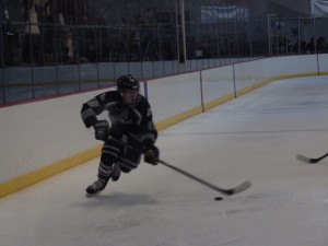 Shen forward Tucker Marvin skates with the puck during the third period. Marvin scored one of Shen's three goals.