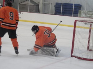 Bethlehem goalie Carl Cusack grabs an errant puck during Friday's game. The Streaks peppered Cusack with 31 shots during the game.