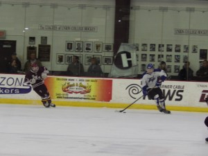 Saratoga's Matt Russell, right, carries the puck pursued by Burnt Hills' Alec Lind.