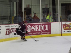 Burnt Hills' Justin Andolina carries the puck during the first period.