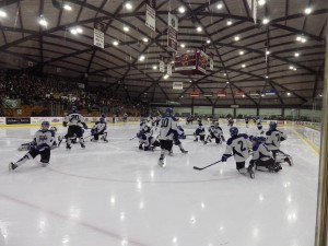 The Blue Streaks warm up for the second period at the Messa Rink.