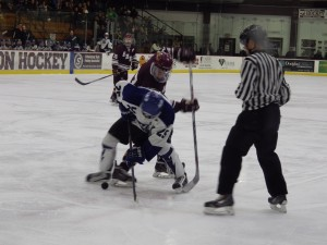 Saratoga's Josh Dagle, front, during a second period faceoff. Dagle would score later in the period during a power play.