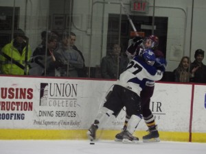 Saratoga's JT Rafferty checks a Burnt Hills player.