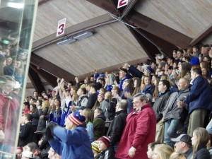 The Saratoga student section celebrates after Elliott Hungerford's goal in the last few seconds of the second period.