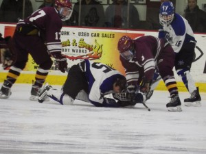Saratoga's Josh Dagle had his helmet come off during a third period faceoff.