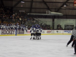 Blue Streaks celebrate Elliott Hungerford's goal midway through the third period.
