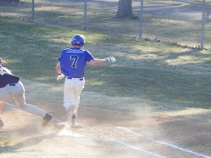 Saratoga outfielder Tom Possidente lands on first base during Wednesday's game against Averill Park.