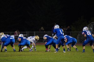 Saratoga and CBA ready for a play during Friday's game at Saratoga Springs High School.