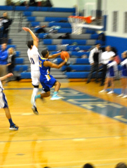 Noah Arciero '14 attempts to block a shot during a recent game against Queensbury.