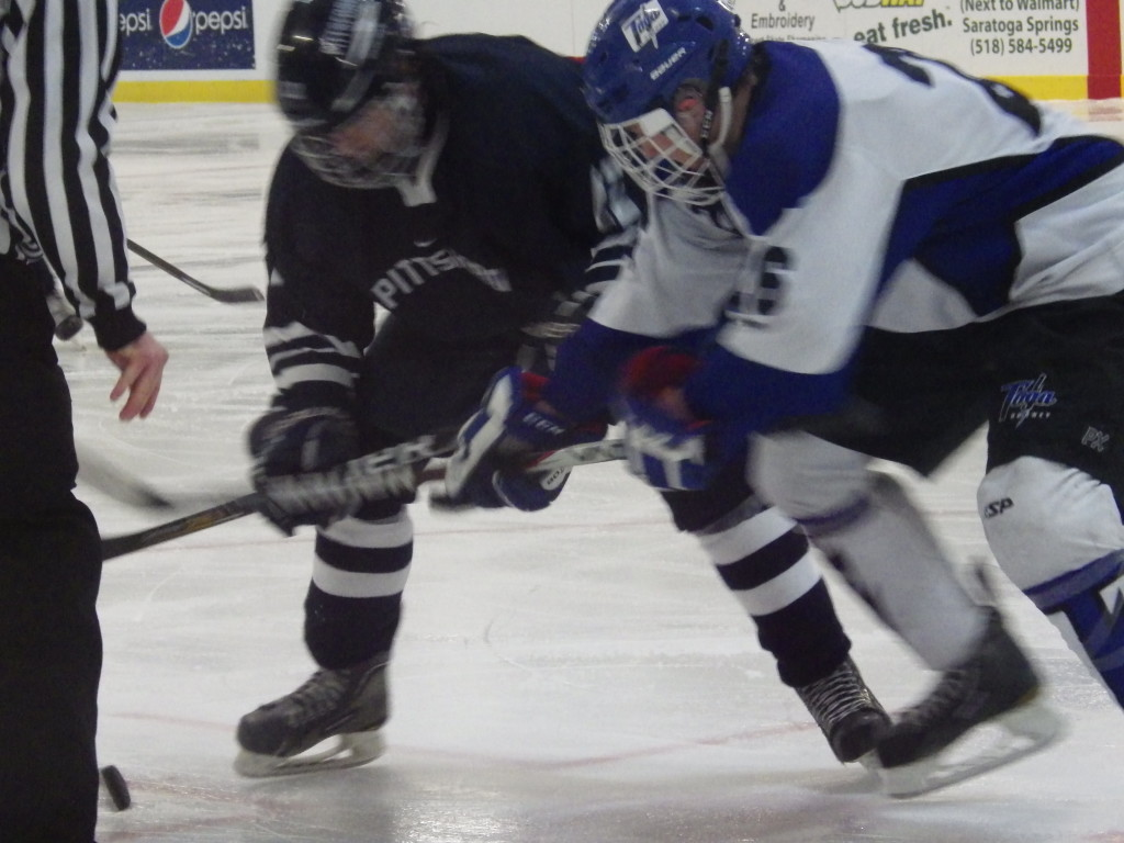 Saratoga forward Elliott hungerford'16 faces off during Friday's game against Pittsford.