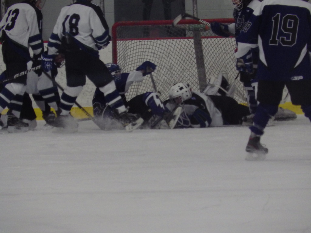 Rivermen goalie Joe Lovering makes a third period save to keep the score tied at 3-3.