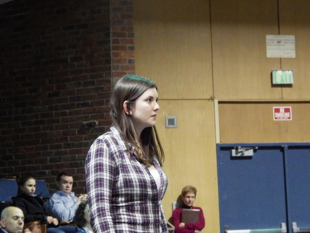 Martha Mastrianni '16 prepares to recite her poem,