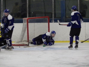 Saratoga defenseman Nick Conchieri '14 after a save during the second period of Saturday's game against Pelham.