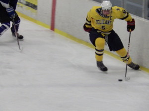 Pelican forward Will Cullen '14 skates down the ice during  the second period of Saturday's game against the blue streaks