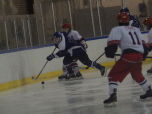 Saratoga defenseman Nick conchieri '14 skates past a Niskayuna/Schenectady player.