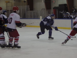 Saratoga defenseman Nick Conchieri '14 makes a pass during the game against Niskayuna/Schenectady.