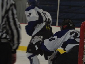 Saratoga goalie Danny Hobbs '16 blocks the goal during the first period of the Queensbury game.