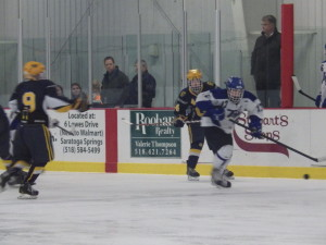 Saratoga's Grayson Rieder '14 breaks ahead with the puck during the second period on Friday.