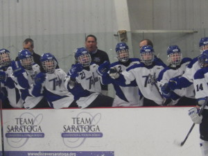 The Saratoga team high-fives Drew Patterson (and others not pictured) after his second period assist