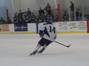 Saratoga's Drew Patterson '14 skates during Thursday's game. He registered one goal and one assist during the game.