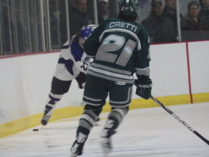 Saratoga's JT Rafferty '15, who remains the Blue Streaks' top goal scorer and scored the Blue Streak's second goal of the game, brings the puck up the ice towards Shenendehowa's Tanner Cretti '14.