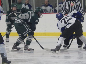Shenendehowa's Peter Russo '14, left, faces off during the third period with Saratoga's Josh Dagle '16. The period saw more success on the part of the Shenedhowa defense as they held off Saratoga for most of the final period after its second-period scoring spree.