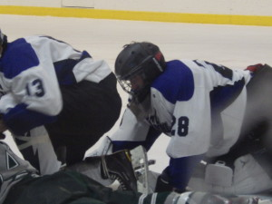Saratoga goalie Danny Hobbs '16 recovers from a scuffle in front of the Blue Streaks goal in the third period.