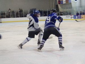Saratoga forward Drew Patterson '14, left, and La Salle forward Peter Hamlin '14 head for the puck during the Friday game in Saratoga Springs.