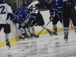 Saratoga forward Josh Dagle '16 (#25, center) struggles with La Salle players during their Friday game.