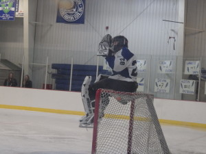 Saratoga goalie Danny Hobbs '16 waves to the fans from atop his goal during the Friday game against LaSalle.