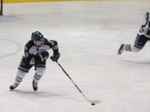 Shen defenseman Tate Cretti '15 brings the puck up the ice during the sectional final game against Saratoga.