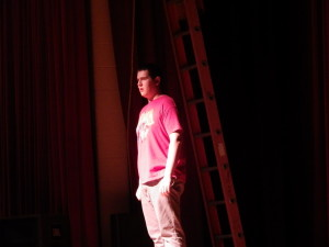 "Jordan Kohn '14 as Reverend Shaw opens a Wednesday rehearsal of ""Footloose."""