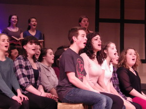 "The cast of ""Footloose"" sings one of the opening numbers during rehearsal on Wednesday."