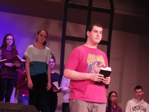 "Jordan Kohn '14 as Reverend Shaw, foreground, during  Wednesday rehearsal for ""Footloose."""