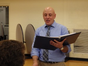 Academic Team Coach Damian Ubriaco asks questions as the team listens at the Night of Inclusion.