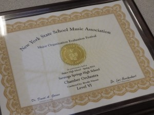 An award to the high school's chamber orchestra is displayed at the Night of Inclusion.