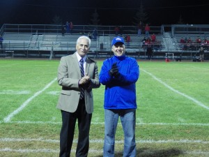 Rich Johns, left, one of the five inductees into the Blue Streak Athletic Hall of Fame, during halftime.