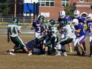 Saratoga running back Darius Wicks (#40) on the field after a tackle by Shen lineman Ben Labonte (#65).